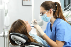 Woman having a cleaning at the dentist